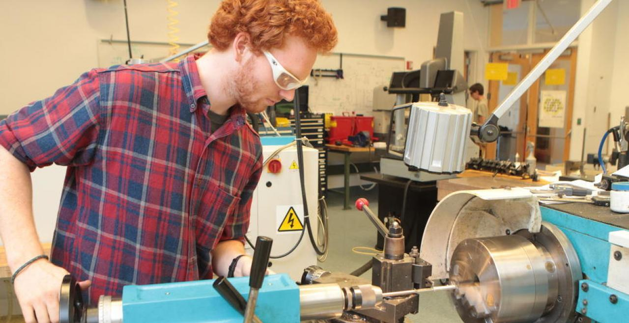 Olin student using a Shop machine